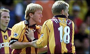 Stuart McCall is held away from Andy Myers