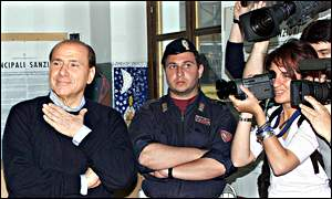 Silvio Berlusconi (left) poses for cameras before voting in Italian elections, 13 May 2001