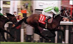 Oath, ridden by Kieren Fallon, strides to victory in the Derby