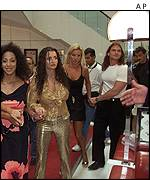 Porn actresses being escorted from the Noga Hilton hotel