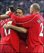 Steven Gerrard is congratulated by Michael Owen and Gary McAllister