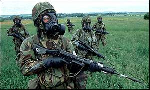 Soldiers in biological warfare kit BBC