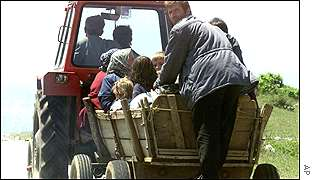 Ethnic Albanians flee from the village of Matejce, near Kumanovo