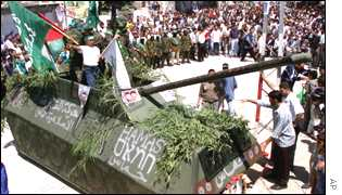 Hamas activists display model of an Israeli tank in Gaza