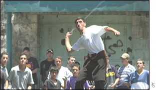 Palestinian youths demonstrating in Hebron