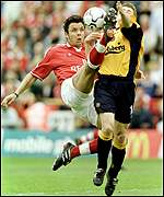 Mark Fish acrobatically denies Michael Owen