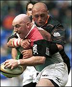 Keith Wood is tackled by Patrick Furet
