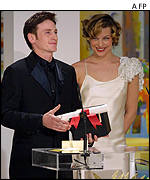 French actor Benoit Magimel received his award from Yugoslavian actress Milla Jovovich
