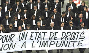 Lawyers carry a banner reading For a state of rights, no impunity