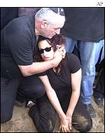 Achiam Polonski comforts his daughter during the funeral of Tersa Polonski, killed by a sucide bomb on Friday