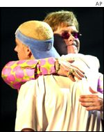 Sir Elton John and Eminem embrace after their duet at the 2001 Grammy Awards