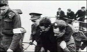 Helping injured ashore, photo courtesy of the Imperial War Museum