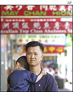 Asian man with child