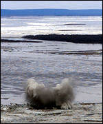 A bomb dropped from an emergency ministry helicopter explodes on the ice jam on the Lena river