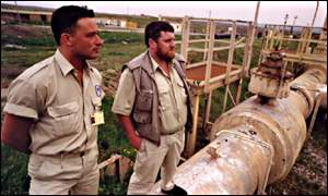 Inspectors at Iraqi oil pipeline