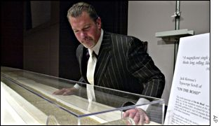 Indianapolis Colts owner James Irsay with the scroll manuscript of On the Road