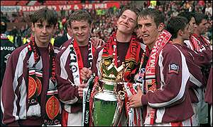 David with Man Utd colleagues and the Premiership trophy in 1996