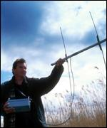 Man monitoring radio collars on voles Martin Senior/WWT