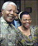 Smiling Graca Machel and Nelson Mandela