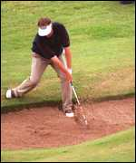 [ image: The shot that nearly won it: Brian Watts in the 18th bunker]