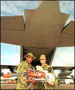 [ image: Australia flying in relief supplies]