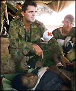 [ image: Australian army doctors treat survivors]