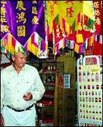 Julian Pettifer in Singapore market with banners - 7/98