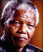 [ image: Nelson Mandela awarded him Honour of Good Hope]