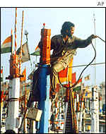 A Gujarat fisherman secures his boat