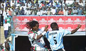 Mtawali wins a header against Botswana in an international for Malawi this year