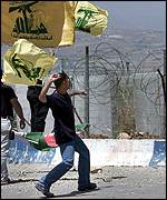 Hezbollah supporter throws stones at Israeli troops on border