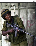 An Israeli soldier prepared for action