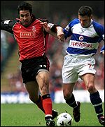 Walsall's Jorge Leitao battles with Reading's Graeme Murty