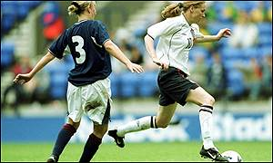 Scotland's Stacey Cook tries to tackle Angela Banks