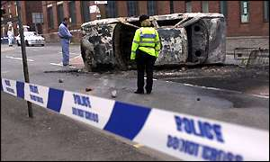 A burnt out car in the streets of Oldham