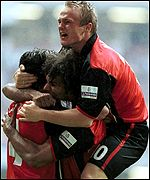 Don Goodman is hugged by his team-mates