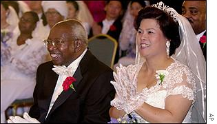 Archbishop Emmanuel Milingo and his bride at a group wedding conducted by the Rev Sun Myung Moon