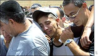 Friends and relatives weep at the funeral for Ricki Cohen and Mordechai Butil in Jerusalem