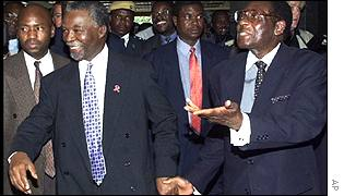 Zimbabwean President Robert Mugabe, right, with South African President Thabo Mbeki in Zimbabwe last year