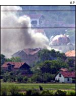 The village of Matejce being shelled
