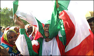 A woman wrapped in the Somaliland flag celebrates outside a polling station