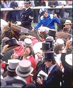 Willie Carson is surrounded by wellwishers after his 1989 triumph on Nashwan