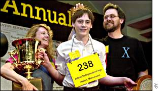 Sean Conley, 13, and his parents after his spelling victory