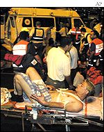 Medics stretcher a survivor to hospital