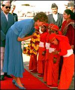 Watched by Prince Dipendra, the late Princess Diana receives flowers in Kathmandu airport in 1993