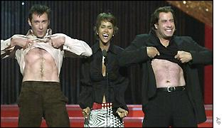 John Travolta, right, and Hugh Jackman, left, clown around with Halle Berry