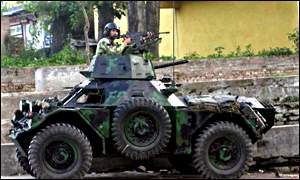 Soldier atop an armoured vehicle