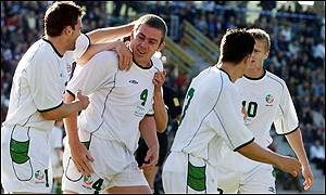 Ireland celebrate Richard Dunne's opener