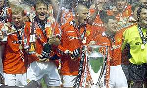 Some of the Manchester United team with the Premiership trophy