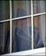 Margaret Thatcher watches from a window as John Major is heralded new party leader
